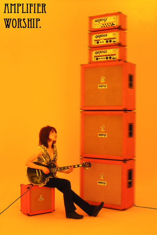 Wata from Boris admiring her stack of Orange amps