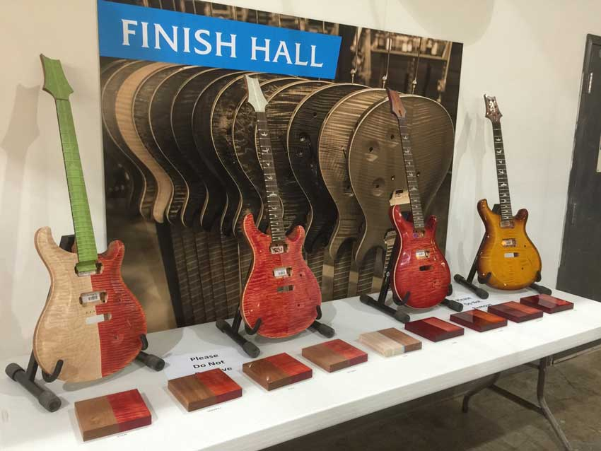 Display showing the different stages of applying the finish to the guitars. Photo credit: Billy P.
