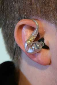 In-ear monitors typically wrap over the ear. (best earbuds guide)