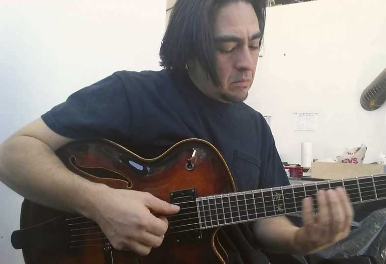 Victor Baker performs on one of his own guitars.