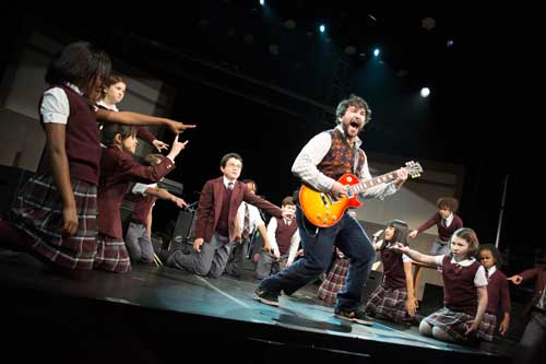 Alex Brightman as Dewey Finn and the kids of School of Rock.