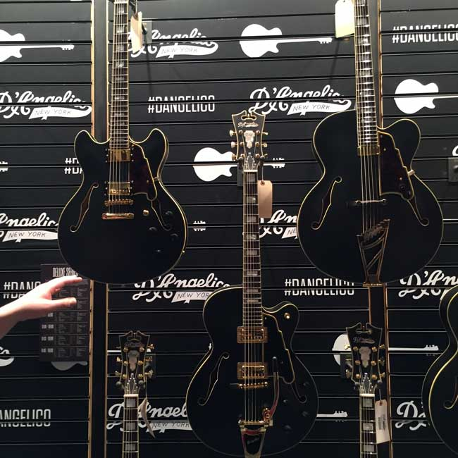 A set of D'Angelico Deluxe Collection guitars at NAMM 2016.
