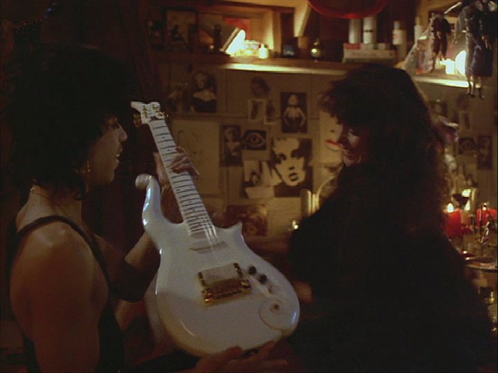 Prince receiving the Cloud Guitar from Vanity in Purple Rain