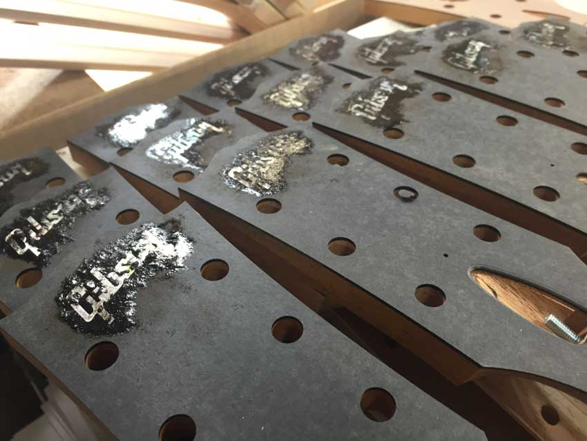 Gibson acoustic headstocks being prepared at the factory in Bozeman, MT.