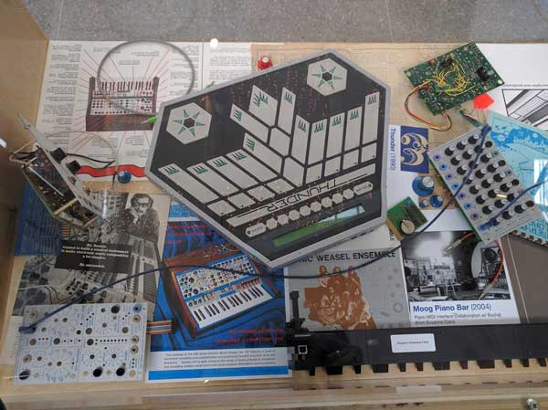 A Buchla Thunder MIDI controller, alongside other memorabilia