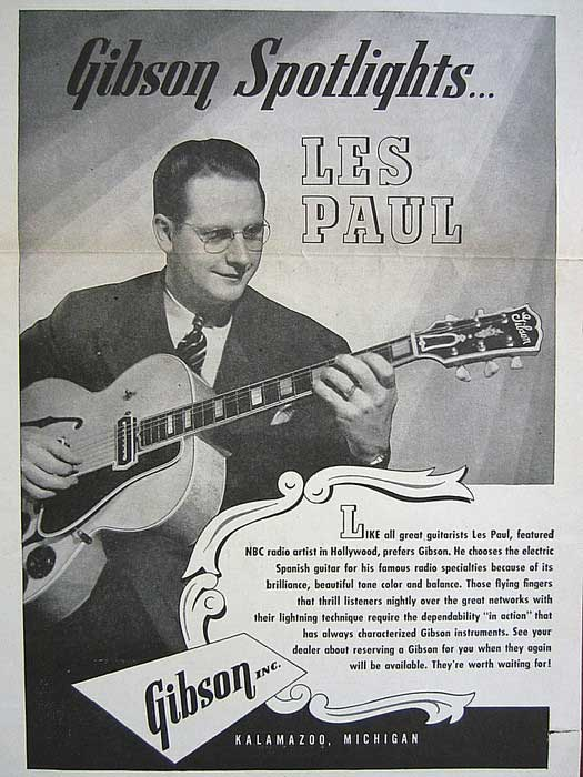 Les Paul shows off a Gibson hollowbody