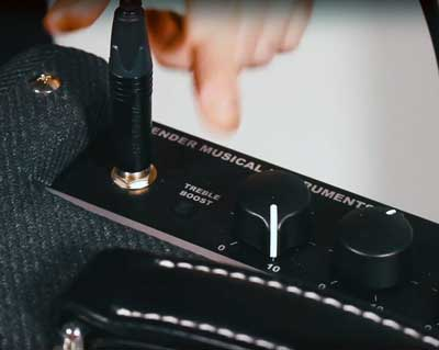 Engaging the Bright switch on a Fender Bassbreaker