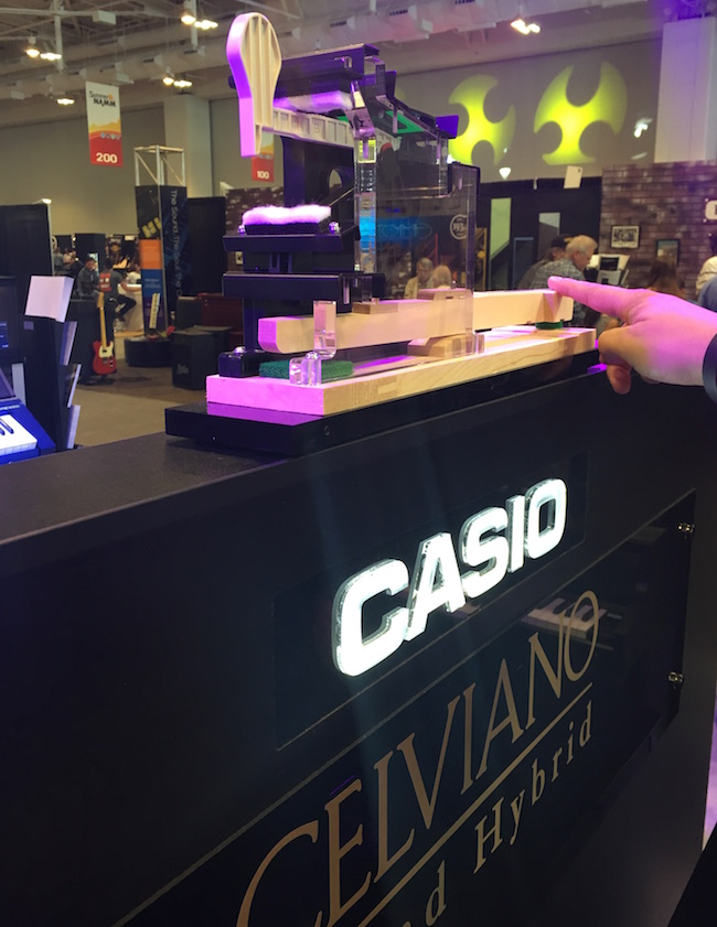 Casio's Celviano Grand Hybrid digital pianos have real wooden keys and hammers inside. Great action!