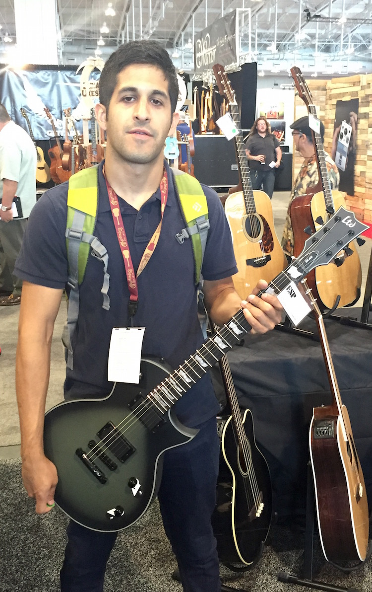 Mason poses with the ESP LTD Bill Kelliher guitar.
