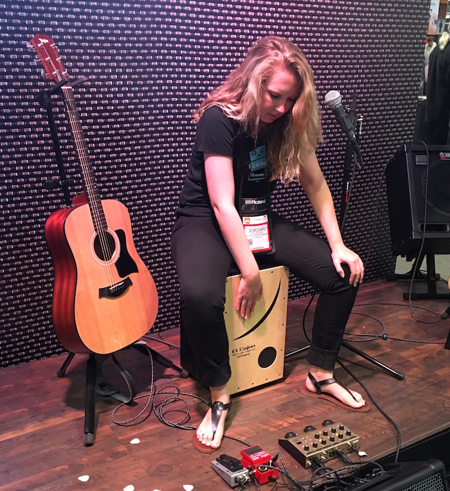 Jordan West performs on the cajon at NAMM