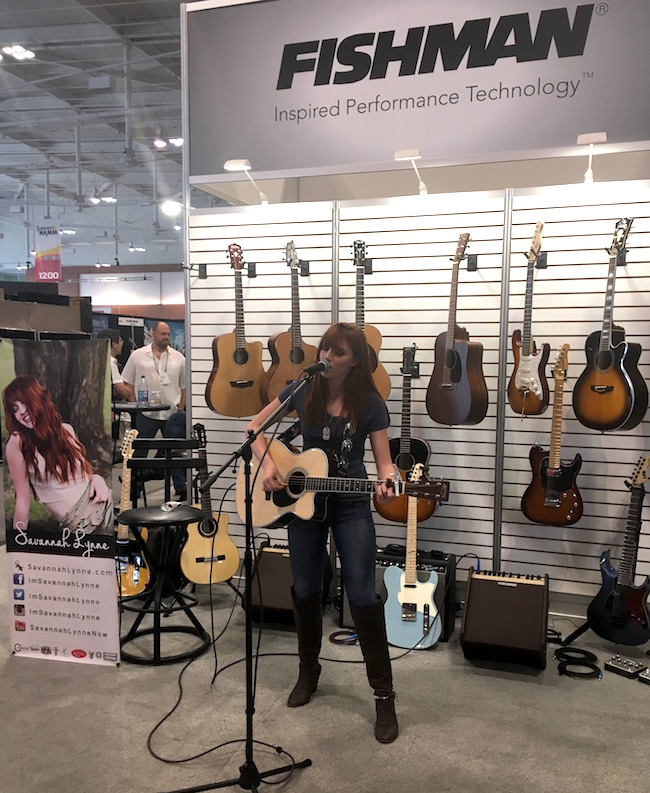 Artist Savannah Lynne covers a Johnny Cash tune at the Fishman booth.