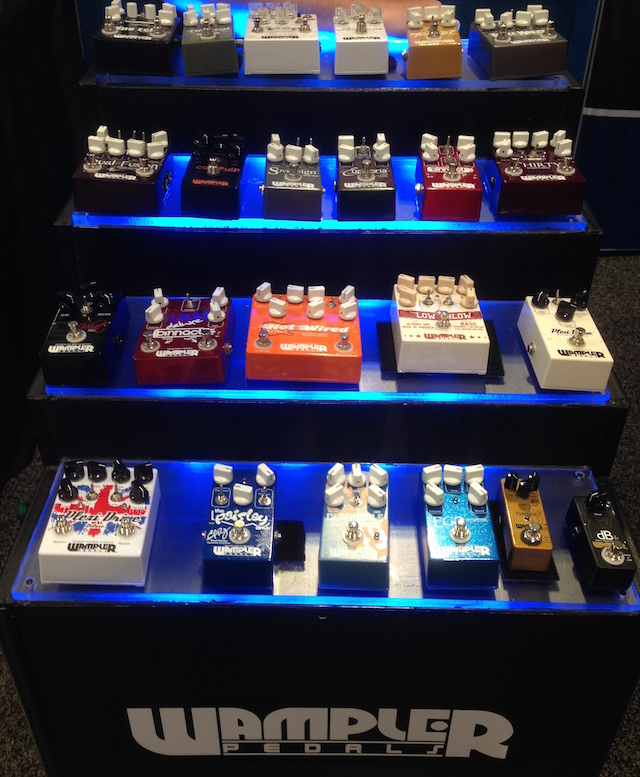 We're at the Wampler booth, drooling over all the pedals!