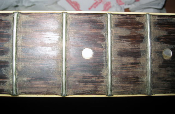 Pictured: A very dirty fretboard. Not mine, mind you!