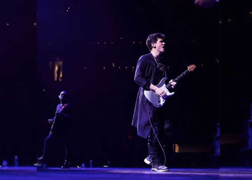 John Mayer playing what appears to be a PRS Stratocaster-style guitar in Boston.
