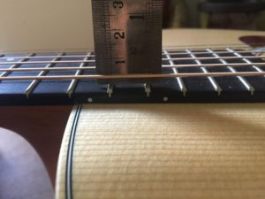Measuring the action of the sixth string