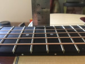 Measuring the action of the first string