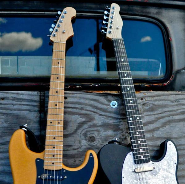 Two guitars with two different shades of Richlite fretboards