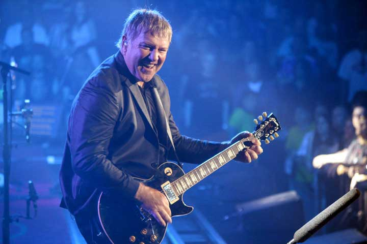 Alex Lifeson on stage with Rush