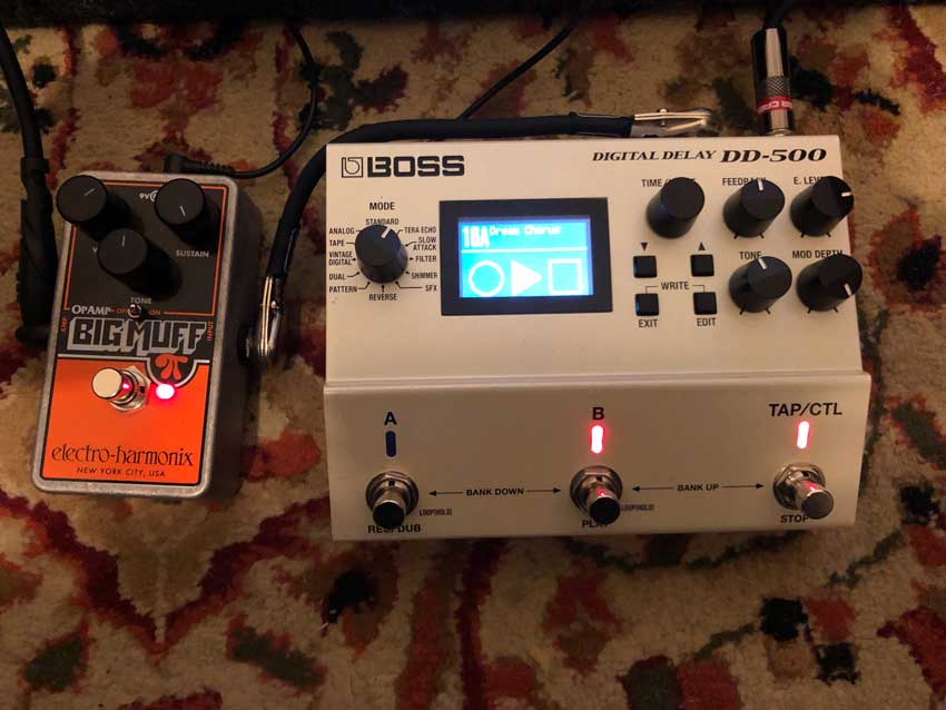 I used a Boss DD-500's looper function to feed an Electro-Harmonix Op Amp Big Muff to create the sounds.