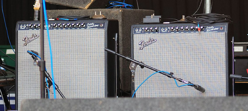A pair of Fender Super Reverbs mic'd onstage at a show by The Animals
