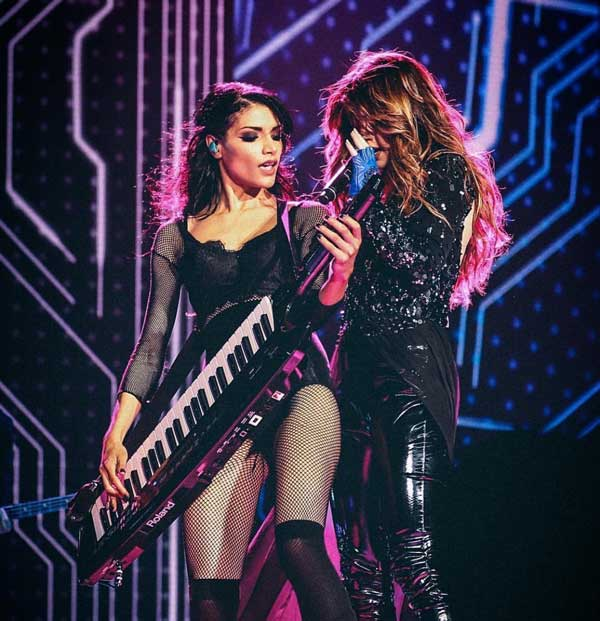 Bonnie McIntosh on her Roland AX-Synth keytar, on stage with Selena Gomez