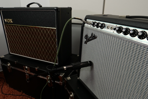 SM57 on Fender amp with Vox amp in background