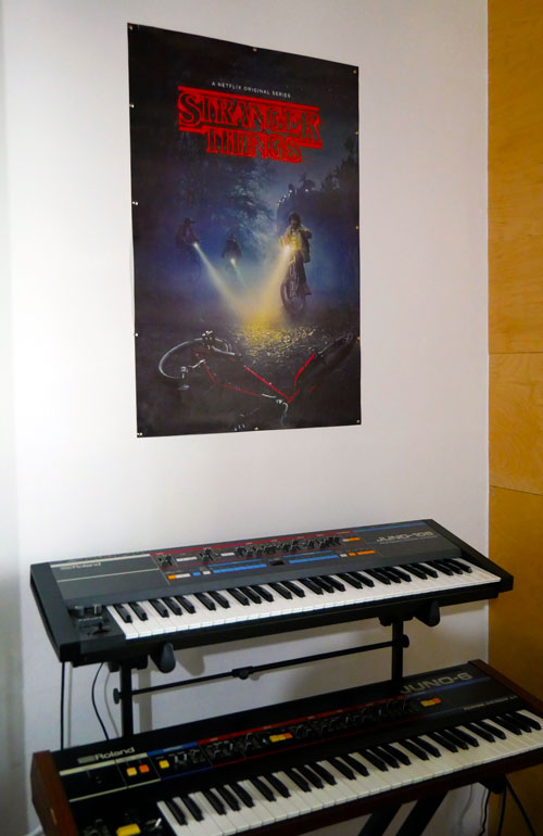 Roland Juno-6 and Juno-106 boards have a place of honor under the Stranger Things poster at Synth House Chicago.