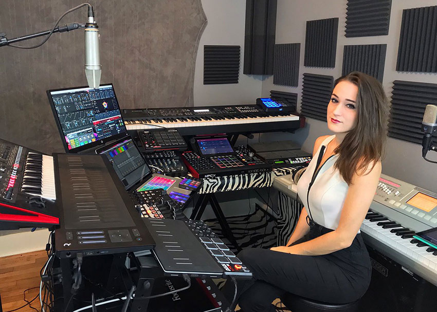 Neon Vines surrounded by her music production gear
