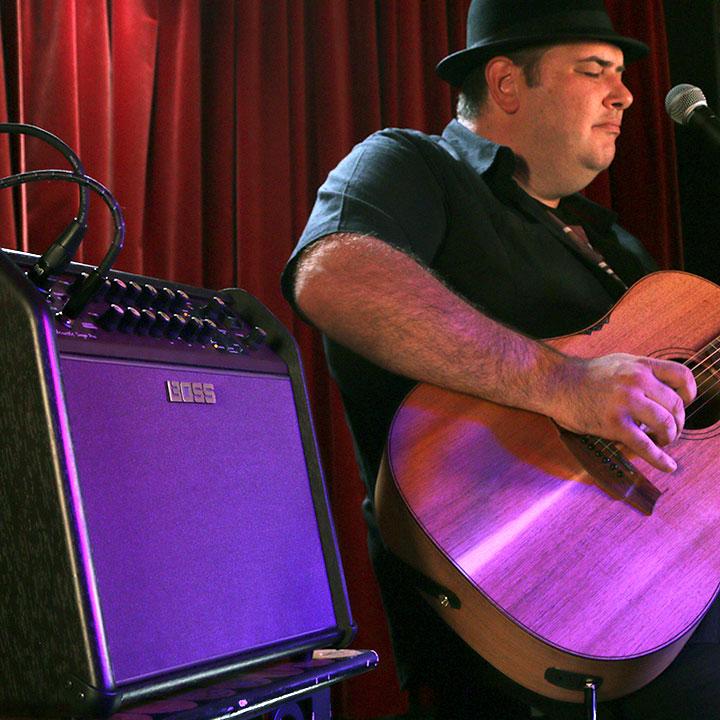 Lloyd Spiegel using a Boss Acoustic Singer amplifier.